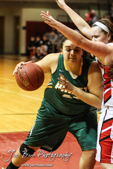 Pratt Lady Greenback Ailin Moreno (#45) drives inside during the Pratt Lady Greenbacks at Hoisington Lady Cardinals Girls Basketball game with Pratt winning 34 to 23 at Hoisington Activity Center in Hoisington, Kansas on January 6, 2015. (Photo: Joey Bahr, www.joeybahr.com)