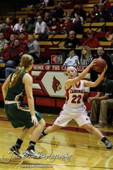 Hoisington Lady Cardinal Marisa Jonas (#22) pulls in a pass during the Pratt Lady Greenbacks at Hoisington Lady Cardinals Girls Basketball game with Pratt winning 34 to 23 at Hoisington Activity Center in Hoisington, Kansas on January 6, 2015. (Photo: Joey Bahr, www.joeybahr.com)