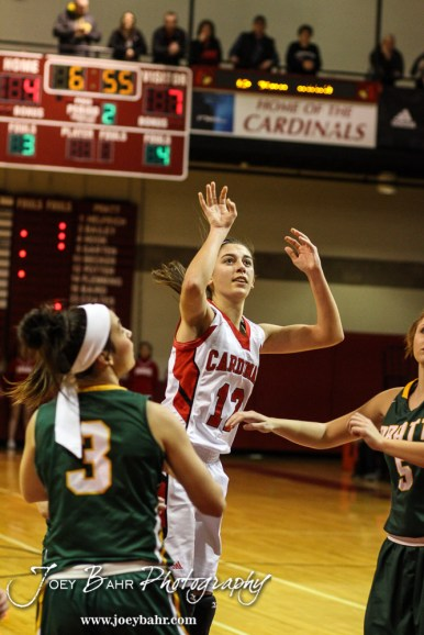 Hoisington Lady Cardinal Rylie Koester (#12) watches her shot go in during the Pratt Lady Greenbacks at Hoisington Lady Cardinals Girls Basketball game with Pratt winning 34 to 23 at Hoisington Activity Center in Hoisington, Kansas on January 6, 2015. (Photo: Joey Bahr, www.joeybahr.com)
