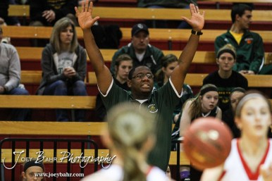 Pratt Lady Greenback Head Coach Emmanuel Adigun tells his players to get their arms up during the Pratt Lady Greenbacks at Hoisington Lady Cardinals Girls Basketball game with Pratt winning 34 to 23 at Hoisington Activity Center in Hoisington, Kansas on January 6, 2015. (Photo: Joey Bahr, www.joeybahr.com)