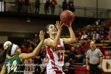 Hoisington Lady Cardinal Rylie Koester (#12) goes up for a layup during the Pratt Lady Greenbacks at Hoisington Lady Cardinals Girls Basketball game with Pratt winning 34 to 23 at Hoisington Activity Center in Hoisington, Kansas on January 6, 2015. (Photo: Joey Bahr, www.joeybahr.com)