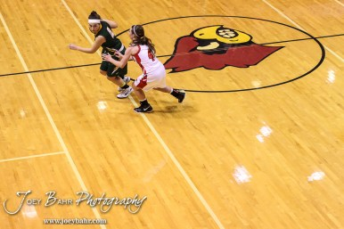 Hoisington Lady Cardinal Karisa Schremmer (#4) plays defense against Pratt Lady Greenback Brooklynn Bourgeois (#4) during the Pratt Lady Greenbacks at Hoisington Lady Cardinals Girls Basketball game with Pratt winning 34 to 23 at Hoisington Activity Center in Hoisington, Kansas on January 6, 2015. (Photo: Joey Bahr, www.joeybahr.com)