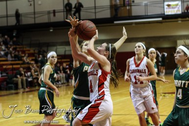Hoisington Lady Cardinal Karisa Schremmer (#4) goes up for a layup during the Pratt Lady Greenbacks at Hoisington Lady Cardinals Girls Basketball game with Pratt winning 34 to 23 at Hoisington Activity Center in Hoisington, Kansas on January 6, 2015. (Photo: Joey Bahr, www.joeybahr.com)