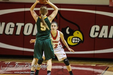 Hoisington Lady Cardinal Rylie Koester (#12) defends Pratt Lady Greenback Destani Garten (#5) during the Pratt Lady Greenbacks at Hoisington Lady Cardinals Girls Basketball game with Pratt winning 34 to 23 at Hoisington Activity Center in Hoisington, Kansas on January 6, 2015. (Photo: Joey Bahr, www.joeybahr.com)