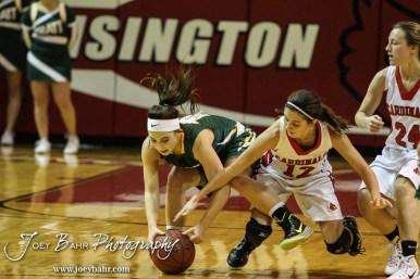 Pratt Lady Greenback Breann Becker (#10) and Hoisington Lady Cardinal Rylie Koester (#12) scramble for a loose ball during the Pratt Lady Greenbacks at Hoisington Lady Cardinals Girls Basketball game with Pratt winning 34 to 23 at Hoisington Activity Center in Hoisington, Kansas on January 6, 2015. (Photo: Joey Bahr, www.joeybahr.com)