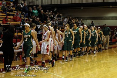 Members of the Hoisington Lady Cardinals and Pratt Lady Greenbacks shake hands following the Pratt Lady Greenbacks at Hoisington Lady Cardinals Girls Basketball game with Pratt winning 34 to 23 at Hoisington Activity Center in Hoisington, Kansas on January 6, 2015. (Photo: Joey Bahr, www.joeybahr.com)