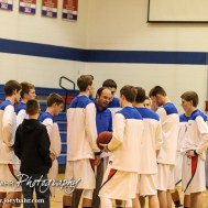 Ellinwood Eagle Head Coach Derek Joiner huddles with his team prior to the 2A Sub-State First Round Game with the Ellinwood Eagles vs the Ell-Saline Cardinals with Ellinwood winning 59 to 37 at Ellinwood High School in Ellinwood, Kansas on March 2, 2015. (Photo: Joey Bahr, www.joeybahr.com)