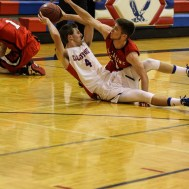 Ell-Saline Cardinal Cody Walters (#31) tries to block a pass from Ellinwood Eagle Marc Waite (#4) during the 2A Sub-State First Round Game with the Ellinwood Eagles vs the Ell-Saline Cardinals with Ellinwood winning 59 to 37 at Ellinwood High School in Ellinwood, Kansas on March 2, 2015. (Photo: Joey Bahr, www.joeybahr.com)
