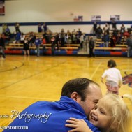 Ellinwood Eagle Head Coach Derek Joiner kisses his daughter after the 2A Sub-State First Round Game with the Ellinwood Eagles vs the Ell-Saline Cardinals with Ellinwood winning 59 to 37 at Ellinwood High School in Ellinwood, Kansas on March 2, 2015. (Photo: Joey Bahr, www.joeybahr.com)