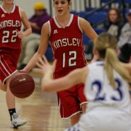 Kinsley Lady Coyote Amber Espinosa (#12) brings the ball down the court during the 2A Sub-State First Round Game with the Spearville Lady Lancers vs the Kinsley Lady Coyotes with Spearville winning 66 to 53 at Spearville High School in Spearville, Kansas on March 3, 2015. (Photo: Joey Bahr, www.joeybahr.com)