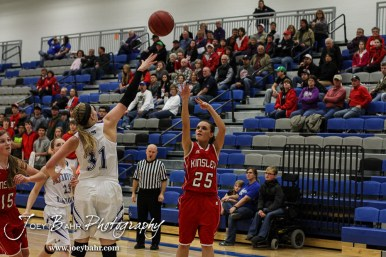 Kinsley Lady Coyote Kate Gleason (#25) takes a shot from behind the arc during the 2A Sub-State First Round Game with the Spearville Lady Lancers vs the Kinsley Lady Coyotes with Spearville winning 66 to 53 at Spearville High School in Spearville, Kansas on March 3, 2015. (Photo: Joey Bahr, www.joeybahr.com)