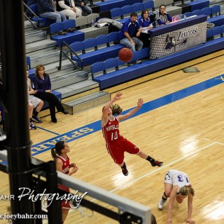 Kinsley Lady Coyote Paige Herrman (#10) fires a shot at the buzzer during the 2A Sub-State First Round Game with the Spearville Lady Lancers vs the Kinsley Lady Coyotes with Spearville winning 66 to 53 at Spearville High School in Spearville, Kansas on March 3, 2015. (Photo: Joey Bahr, www.joeybahr.com)