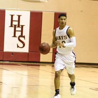 Hays Indian Isaiah Nunnery (#10) brings the ball down the court during the 4A Division I Sub-State First Round Game with the Hays Indians and Buhler Crusaders with Hays winning 60 to 53 at Hays High School in Hays, Kansas on March 5, 2015. (Photo: Joey Bahr, www.joeybahr.com)