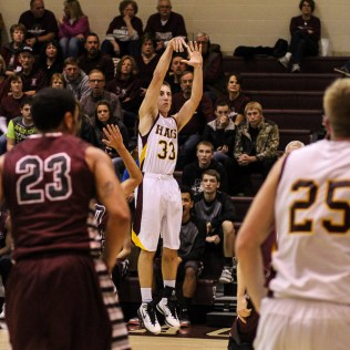 Hays Indian Cash Hobson (#33) shoots from behind the arc during the 4A Division I Sub-State First Round Game with the Hays Indians and Buhler Crusaders with Hays winning 60 to 53 at Hays High School in Hays, Kansas on March 5, 2015. (Photo: Joey Bahr, www.joeybahr.com)