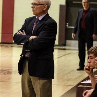 Buhler Crusader Head Coach Dennis Wahlgren watches a play develop during the 4A Division I Sub-State First Round Game with the Hays Indians and Buhler Crusaders with Hays winning 60 to 53 at Hays High School in Hays, Kansas on March 5, 2015. (Photo: Joey Bahr, www.joeybahr.com)