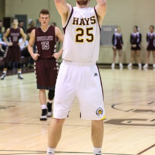 Hays Indian Brady Werth (#25) shoots a free throw during the 4A Division I Sub-State First Round Game with the Hays Indians and Buhler Crusaders with Hays winning 60 to 53 at Hays High School in Hays, Kansas on March 5, 2015. (Photo: Joey Bahr, www.joeybahr.com)