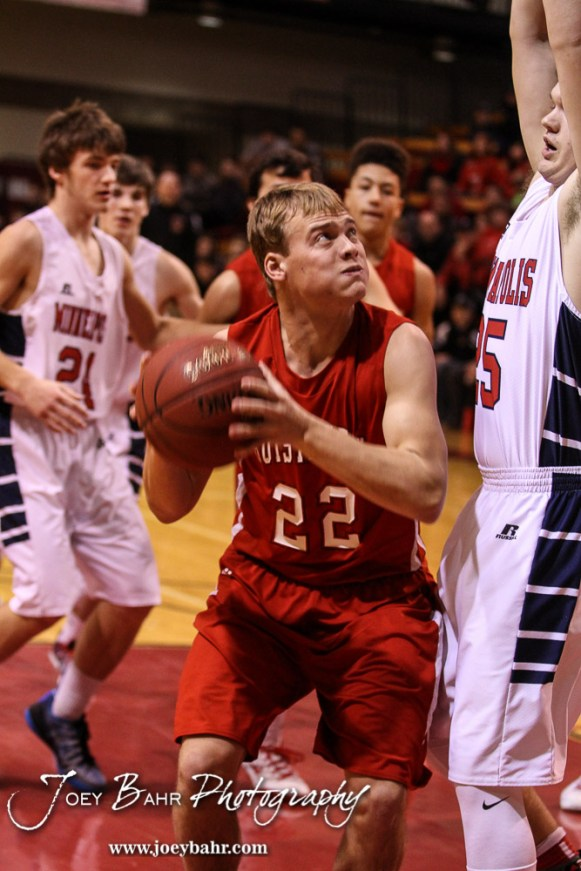 Hoisington Cardinal Grant Dolechek (#22) prepares to go up for a shot as Minneapolis Lion Jace McKinney (#25) defends during the 2016 Hoisington Winter Jam Boys Championship Basketball game between the Hoisington Cardinals and the Minneapolis Lions with Hoisington winning 39 to 38 of Hoisington Activity Center in Hoisington, Kansas on January 23, 2016. (Photo: Joey Bahr, www.joeybahr.com)