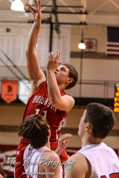 Hoisington Cardinal Tyler Specht (#11) shoots a jump shot during the 2016 Hoisington Winter Jam Boys Championship Basketball game between the Hoisington Cardinals and the Minneapolis Lions with Hoisington winning 39 to 38 of Hoisington Activity Center in Hoisington, Kansas on January 23, 2016. (Photo: Joey Bahr, www.joeybahr.com)