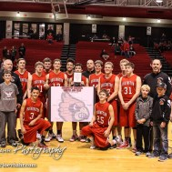 The Hoisington Cardinals pose with the Championship Trophy and Bracket following the 2016 Hoisington Winter Jam Boys Championship Basketball game between the Hoisington Cardinals and the Minneapolis Lions with Hoisington winning 39 to 38 of Hoisington Activity Center in Hoisington, Kansas on January 23, 2016. (Photo: Joey Bahr, www.joeybahr.com)
