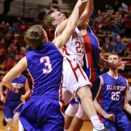 Ellinwood Eagles Kaleb Schartz (#3) and Ellinwood Eagle Nathan Monday (#35) try to block the shot of Hoisington Cardinal Grant Dolechek (#22) during the 2016 Hoisington Winter Jam Boys Semi-Final Basketball game between the Hoisington Cardinals and the Ellinwood Eagles with Hoisington winning 42 to 39 of Hoisington Activity Center in Hoisington, Kansas on January 22, 2016. (Photo: Joey Bahr, www.joeybahr.com)