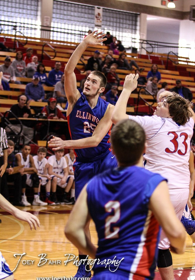 Ellinwood Eagle Cody Wondra (#25) goes for a layup as Russell Bronco Mason Beagley (#33) defends during the 2016 Hoisington Winter Jam Boys Thrid Place Basketball game between the Ellinwood Eagles and the Russell Broncos with Ellinwood winning 47 to 37 of Hoisington Activity Center in Hoisington, Kansas on January 23, 2016. (Photo: Joey Bahr, www.joeybahr.com)