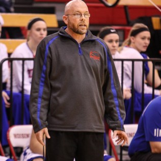 Russell Bronco Head Coach Eric Swanson watches a play develop during the 2016 Hoisington Winter Jam Boys Thrid Place Basketball game between the Ellinwood Eagles and the Russell Broncos with Ellinwood winning 47 to 37 of Hoisington Activity Center in Hoisington, Kansas on January 23, 2016. (Photo: Joey Bahr, www.joeybahr.com)