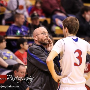 Russell Bronco Head Coach Eric Swanson talks with Ochs (#3) during the 2016 Hoisington Winter Jam Boys Thrid Place Basketball game between the Ellinwood Eagles and the Russell Broncos with Ellinwood winning 47 to 37 of Hoisington Activity Center in Hoisington, Kansas on January 23, 2016. (Photo: Joey Bahr, www.joeybahr.com)