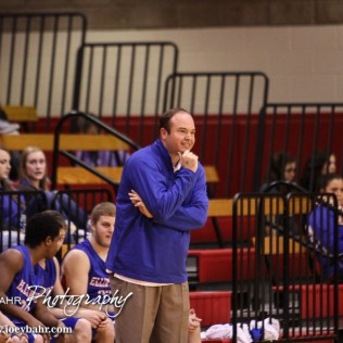 Ellinwood Eagle Head Coach Derek Joiner takes a moment to enjoy the win during the 2016 Hoisington Winter Jam Boys Thrid Place Basketball game between the Ellinwood Eagles and the Russell Broncos with Ellinwood winning 47 to 37 of Hoisington Activity Center in Hoisington, Kansas on January 23, 2016. (Photo: Joey Bahr, www.joeybahr.com)