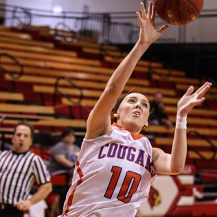 Otis-Bison Lady Cougar Taylor Regan (#10) shoots a layup during the 2016 Hoisington Winter Jam Girls Fifth Place Basketball game between the Otis-Bison Lady Cougars and the Ellsworth Lady Bearcats with Otis-Bison winning 46 to 40 of Hoisington Activity Center in Hoisington, Kansas on January 23, 2016. (Photo: Joey Bahr, www.joeybahr.com)