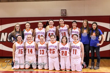 The Otis-Bison Lady Cougars line up for a picture following the 2016 Hoisington Winter Jam Girls Fifth Place Basketball game between the Otis-Bison Lady Cougars and the Ellsworth Lady Bearcats with Otis-Bison winning 46 to 40 of Hoisington Activity Center in Hoisington, Kansas on January 23, 2016. (Photo: Joey Bahr, www.joeybahr.com)