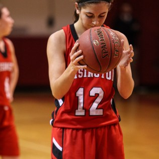 Hoisington Lady Cardinal Rylie Koester (#12) prepares to shoot a free throw during the 2016 Hoisington Winter Jam Girls Semi-Final Basketball game between the LaCrosse Lady Leopards and the Hoisington Lady Cardinals with LaCrosse winning 42 to 39 of Hoisington Activity Center in Hoisington, Kansas on January 22, 2016. (Photo: Joey Bahr, www.joeybahr.com)