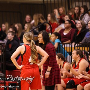 Hoisington Lady Cardinal Head Coach Mandy Mason talks to Karisa Schremmer (#4) during the 2016 Hoisington Winter Jam Girls Semi-Final Basketball game between the LaCrosse Lady Leopards and the Hoisington Lady Cardinals with LaCrosse winning 42 to 39 of Hoisington Activity Center in Hoisington, Kansas on January 22, 2016. (Photo: Joey Bahr, www.joeybahr.com)