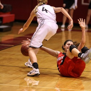 Hoisington Lady Cardinal Rylie Koester (#12) tries to knock away the ball after LaCrosse Lady Leopard Erica Gilbert (#4) stole it during the 2016 Hoisington Winter Jam Girls Semi-Final Basketball game between the LaCrosse Lady Leopards and the Hoisington Lady Cardinals with LaCrosse winning 42 to 39 of Hoisington Activity Center in Hoisington, Kansas on January 22, 2016. (Photo: Joey Bahr, www.joeybahr.com)