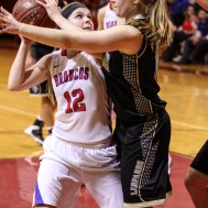 Russell Lady Bronco Sam Ptacek (#12) goes deep in the lane with the ball as LaCrosse Lady Leopard Tessa Pierce (#11) defends during the 2016 Hoisington Winter Jam Girls Championship Basketball game between the LaCrosse Lady Leopards and the Russell Lady Broncos with LaCrosse winning 54 to 48 of Hoisington Activity Center in Hoisington, Kansas on January 23, 2016. (Photo: Joey Bahr, www.joeybahr.com)