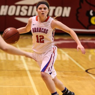 Russell Lady Bronco Sam Ptacek (#12) looks for a teammate to pass the ball to during the 2016 Hoisington Winter Jam Girls Championship Basketball game between the LaCrosse Lady Leopards and the Russell Lady Broncos with LaCrosse winning 54 to 48 of Hoisington Activity Center in Hoisington, Kansas on January 23, 2016. (Photo: Joey Bahr, www.joeybahr.com)