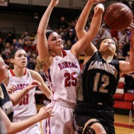 LaCrosse Lady Leopard Mary Lacy (#12) pulls in a rebound contested by Russell Lady Bronco Jaclyn Schulte (#25) during the 2016 Hoisington Winter Jam Girls Championship Basketball game between the LaCrosse Lady Leopards and the Russell Lady Broncos with LaCrosse winning 54 to 48 of Hoisington Activity Center in Hoisington, Kansas on January 23, 2016. (Photo: Joey Bahr, www.joeybahr.com)