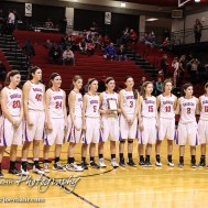 The Russell Lady Broncos line up for pictures with the Second Place Trophy after the 2016 Hoisington Winter Jam Girls Championship Basketball game between the LaCrosse Lady Leopards and the Russell Lady Broncos with LaCrosse winning 54 to 48 of Hoisington Activity Center in Hoisington, Kansas on January 23, 2016. (Photo: Joey Bahr, www.joeybahr.com)