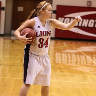 Minneapolis Lady Lion Nicole Forte (#34) signals for a teammate to get in place during the 2016 Hoisington Winter Jam Girls Thrid Place Basketball game between the Hoisington Lady Cardinals and the Minneapolis Lady Lions with Hoisington winning 48 to 43 of Hoisington Activity Center in Hoisington, Kansas on January 23, 2016. (Photo: Joey Bahr, www.joeybahr.com)