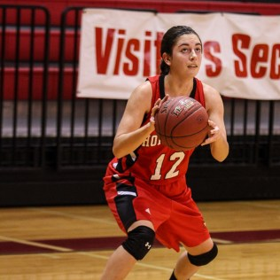 Hoisington Lady Cardinal Rylie Koester (#12) looks to take a shot during the 2016 Hoisington Winter Jam Girls Thrid Place Basketball game between the Hoisington Lady Cardinals and the Minneapolis Lady Lions with Hoisington winning 48 to 43 of Hoisington Activity Center in Hoisington, Kansas on January 23, 2016. (Photo: Joey Bahr, www.joeybahr.com)