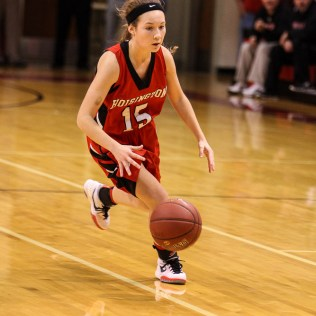 Hoisington Lady Cardinal Emma Harmon (#15) brings the ball to the top of the key during the 2016 Hoisington Winter Jam Girls Thrid Place Basketball game between the Hoisington Lady Cardinals and the Minneapolis Lady Lions with Hoisington winning 48 to 43 of Hoisington Activity Center in Hoisington, Kansas on January 23, 2016. (Photo: Joey Bahr, www.joeybahr.com)