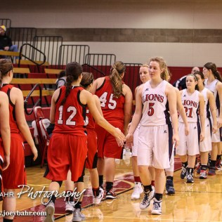 Members of the Hoisington Lady Cardinals and Minneapolis Lady Lions shake hands following the 2016 Hoisington Winter Jam Girls Thrid Place Basketball game between the Hoisington Lady Cardinals and the Minneapolis Lady Lions with Hoisington winning 48 to 43 of Hoisington Activity Center in Hoisington, Kansas on January 23, 2016. (Photo: Joey Bahr, www.joeybahr.com)