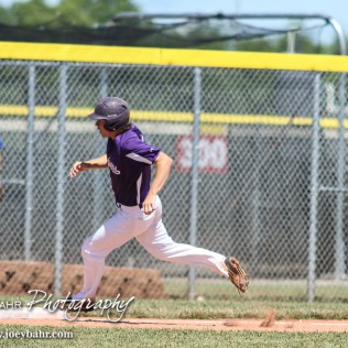 Medicine Lodge Indian Micah Richert (#11) rounds Third Base on his way home to score. The St. Mary's Colgan Panthers win the KSHSAA Class 2-1A State Baseball Championship over the Medicine Lodge Indians by a score of 13 to 3 at the Great Bend Sports Complex in Great Bend, Kansas on May 28, 2016. (Photo: Joey Bahr, www.joeybahr.com)