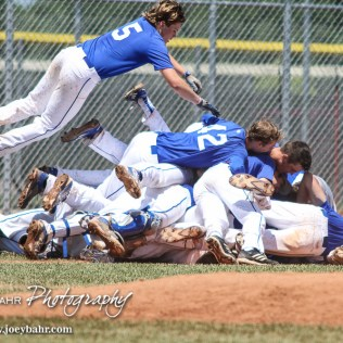 St. Mary's Colgan Panther Drew Beck (#5) jumps onto the dog pile of his teammates to celebrate their State Championship victory. The St. Mary's Colgan Panthers win the KSHSAA Class 2-1A State Baseball Championship over the Medicine Lodge Indians by a score of 13 to 3 at the Great Bend Sports Complex in Great Bend, Kansas on May 28, 2016. (Photo: Joey Bahr, www.joeybahr.com)