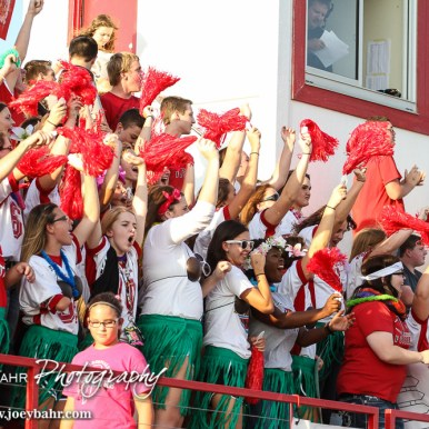 The Hoisington Cardinal Student Section cheers a touchdown being scored during the Hoisington Cardinal versus Larned Indian Football game with Hoisington winning 53 to 21 at Elton Brown Field in Hoisington, Kansas on September 4, 2015. (Photo: Joey Bahr, www.joeybahr.com)