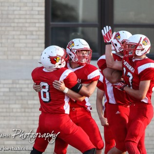 The Hoisington Cardinals celebrate Hunter Hanzlick's (#27) touchdown during the Hoisington Cardinal versus Larned Indian Football game with Hoisington winning 53 to 21 at Elton Brown Field in Hoisington, Kansas on September 4, 2015. (Photo: Joey Bahr, www.joeybahr.com)