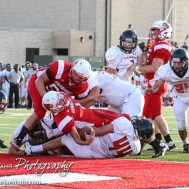 Hoisington Cardinal Tyler Specht (#1) stretches across the goal line for a two point conversion during the Hoisington Cardinal versus Larned Indian Football game with Hoisington winning 53 to 21 at Elton Brown Field in Hoisington, Kansas on September 4, 2015. (Photo: Joey Bahr, www.joeybahr.com)