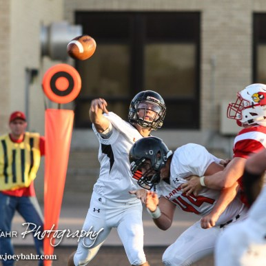 Larned Indian Evan Skelton (#1) throws a pass during the Hoisington Cardinal versus Larned Indian Football game with Hoisington winning 53 to 21 at Elton Brown Field in Hoisington, Kansas on September 4, 2015. (Photo: Joey Bahr, www.joeybahr.com)