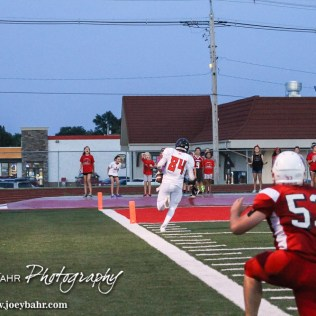 Larned Indian Isiah Perez (#84) runs for the end zone during the Hoisington Cardinal versus Larned Indian Football game with Hoisington winning 53 to 21 at Elton Brown Field in Hoisington, Kansas on September 4, 2015. (Photo: Joey Bahr, www.joeybahr.com)