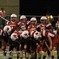 The Hoisington Cardinals wait for the next play during the Hoisington Cardinal versus Larned Indian Football game with Hoisington winning 53 to 21 at Elton Brown Field in Hoisington, Kansas on September 4, 2015. (Photo: Joey Bahr, www.joeybahr.com)