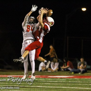 Hoisington Cardinal Jonathan Ball (#30) breaks up a pass intended for Larned Indian Isiah Perez (#84) during the Hoisington Cardinal versus Larned Indian Football game with Hoisington winning 53 to 21 at Elton Brown Field in Hoisington, Kansas on September 4, 2015. (Photo: Joey Bahr, www.joeybahr.com)